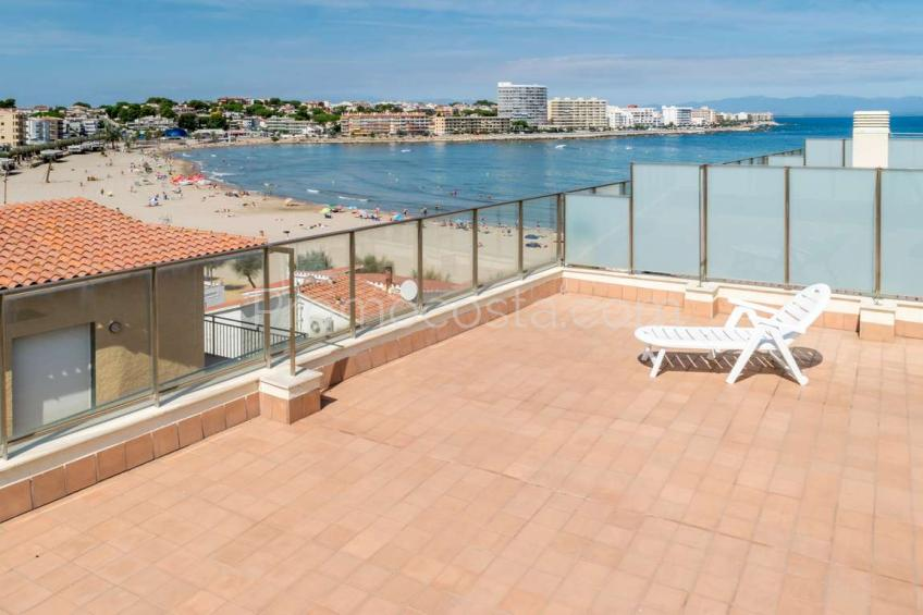 Beach front line - duplex penthouse with large terrace and sea view .